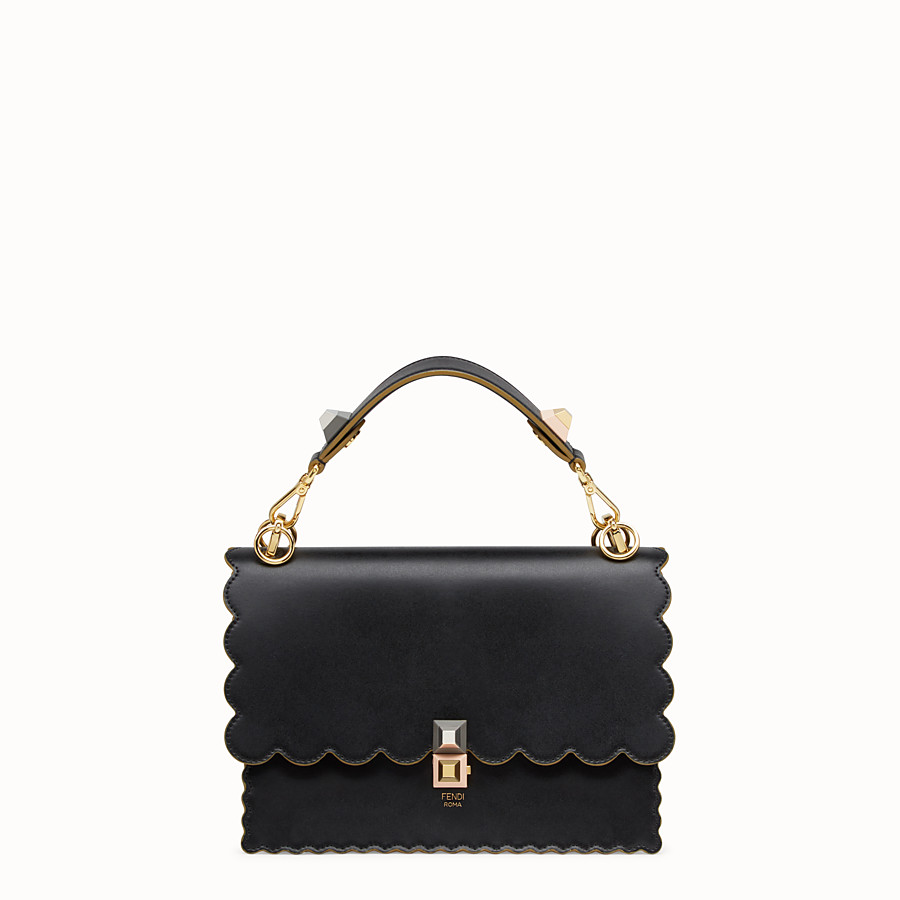 Kan I - Black and gold leather bag